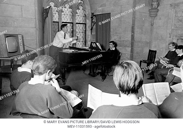 Schoolboys and a teacher at work in a singing class at Atlantic College (United World College of the Atlantic), St Donat's Castle, Llantwit Major, Glamorgan