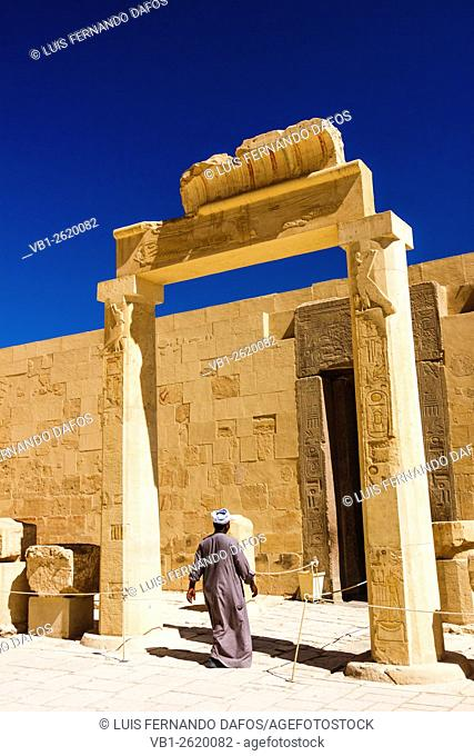 Egyptian man at the entrance of the Hathor Chapel at the Temple of Hatshepsut, Luxor, West Bank, Egypt