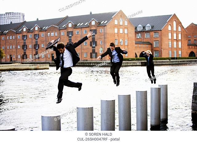 Three businesspeople jumping