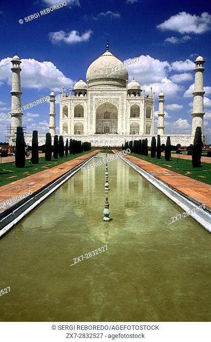 Agra, Uttar Pradesh. Taj Mahal in River Yamuna, Agra, India The Taj Mahal is a mausoleum located in Agra, India, built by Mughal Emperor Shah Jahan in memory of...