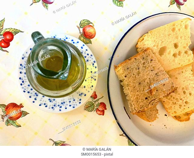 Bread and olive oil. View from above