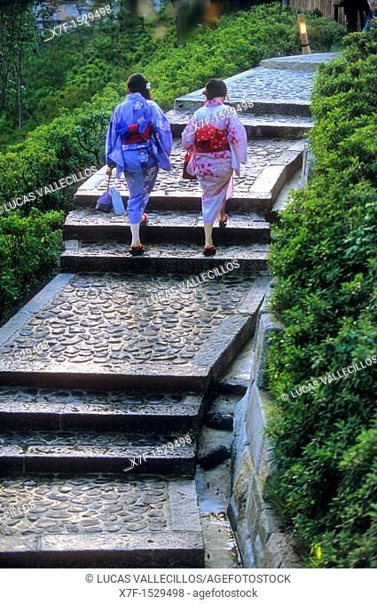 women wearing kimono, they are walking up the stairs to the Ryozen Kannon temple ,Kyoto, Japan