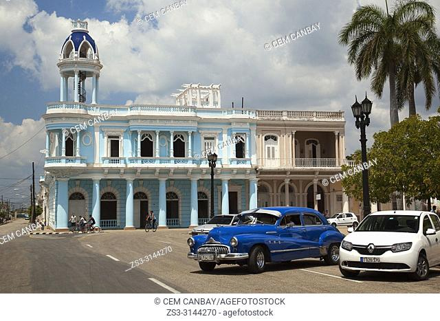 Vintage American car in front of the Ferrer Palace-Palacio Ferrer in Parque Jose Marti-Jose Marti park in the historic centre, Cienfuegos, Cuba, West Indies