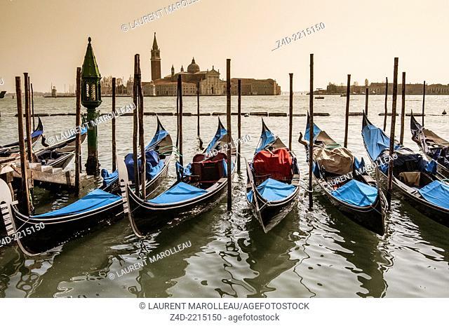 Venetian Gondolas and San Giorgio Maggiore island. San Marco district, Venice, Veneto region, Italy, Europe