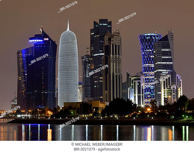 Night scene, skyline of Doha with Al Bidda Tower, World Trade Center, Palm Tower 1 and 2, Burj Qatar Tower with silver illumination, Tornado Tower