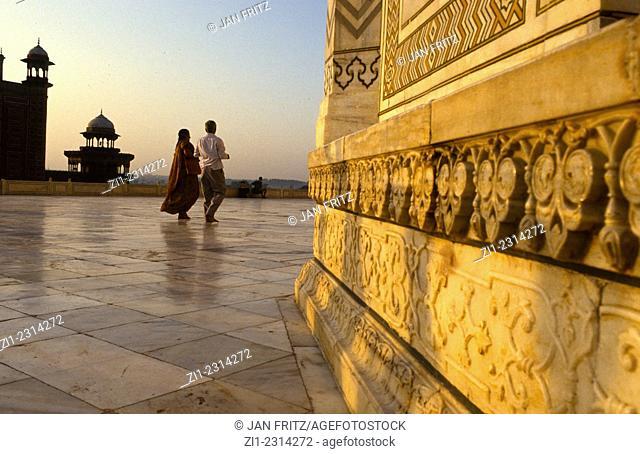 detail of Taj Mahal with visitors in Agra, India