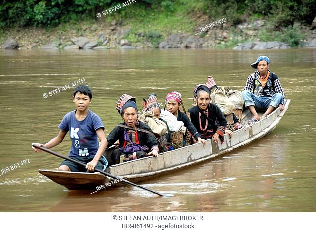 Women from the Akha people, dressed in traditional costume, crossing the Nam Ou River in a boat, Phongsali province, Laos, Asia