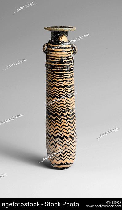 Glass alabastron (perfume bottle). Period: Classical; Date: 5th century B.C; Culture: Greek, Eastern Mediterranean; Medium: Glass; core-formed