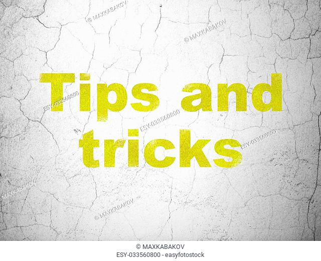 Education concept: Yellow Tips And Tricks on textured concrete wall background