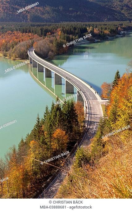 Autumnal mountain forest at the bridge at Sylvenstein Dam, Fall village near Lenggries, Upper Bavaria, Bavaria, Germany