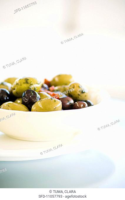 A bowl of various olives