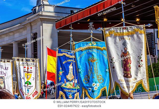 Banners May 13 Apparation Day Basilica of Lady of Rosary Bell Tower Fatima Portugal. Church created on site where three Portuguese Shepherd children saw Virgin...