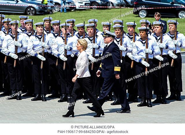 17 June 2019, Lower Saxony, Wilhelmshaven: Defense Minister Ursula von der Leyen (CDU) walks along the naval base Wilhelmshaven in front of marines during the...