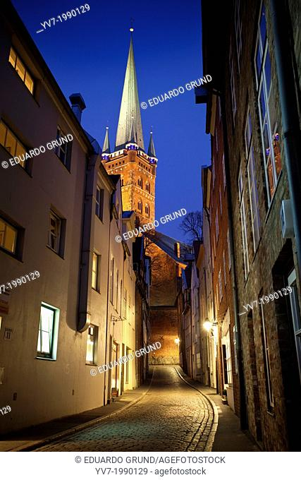 View at dusk from the Church of St. Petri from an alley. Lubeck, Schleswig-Holstein, Germany
