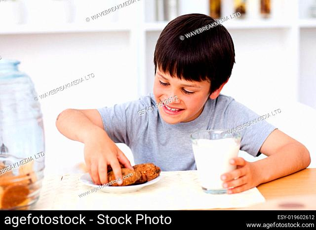 Little boy eating cookies