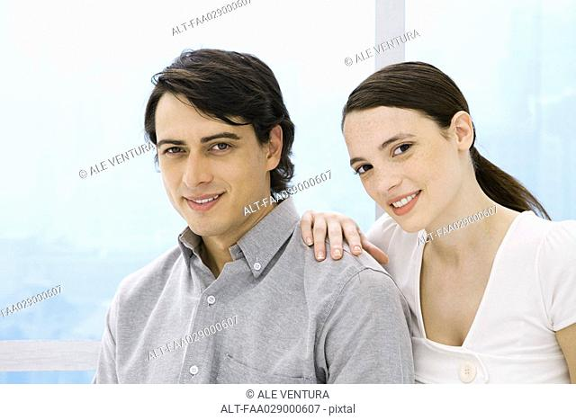 Couple smiling at camera, portrait