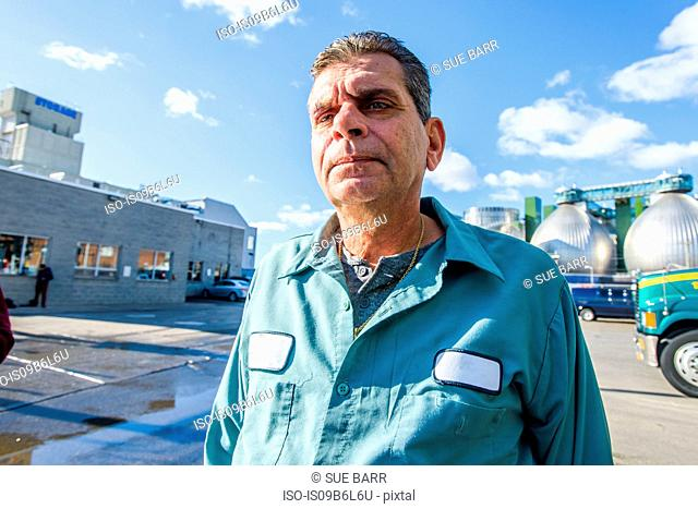Portrait of male worker at biofuel industrial plant