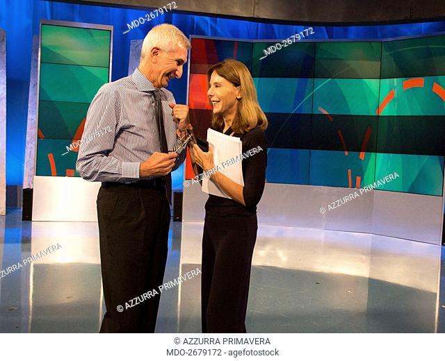Baskstage of the TV show 'Unomattina': Italian TV host Umberto Broccoli - the editor of «In diretta dalla storia» - talking to the author in chief Paola...