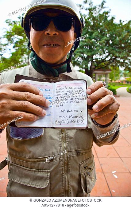 Man with bike, works as a freelance guide for tourists.  HANOI VIETNAM
