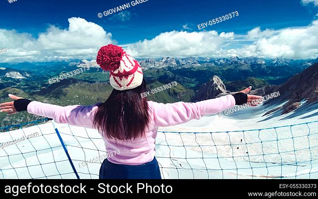 Woman embracing wonderful mountain landscape with glacier