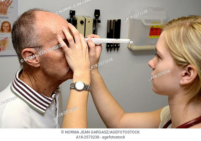 A patient undergoes a healthy eye screening for cataracts, glaucoma, diabetes, macular degeneration and dry eye