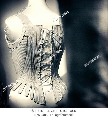 Back view of female mannequin with an old corset, London, England, UK