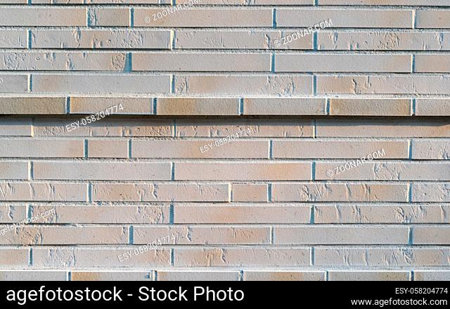 Solid new gray stone wall with a highlighted wall stripe