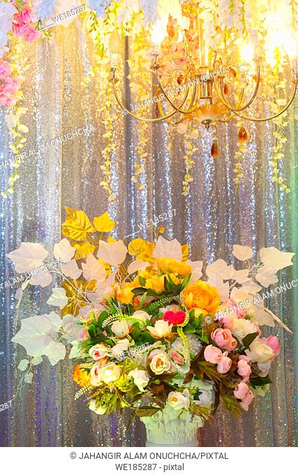 Hand made paper flower and decorative lighting, Wedding decoration stage in Bangladesh