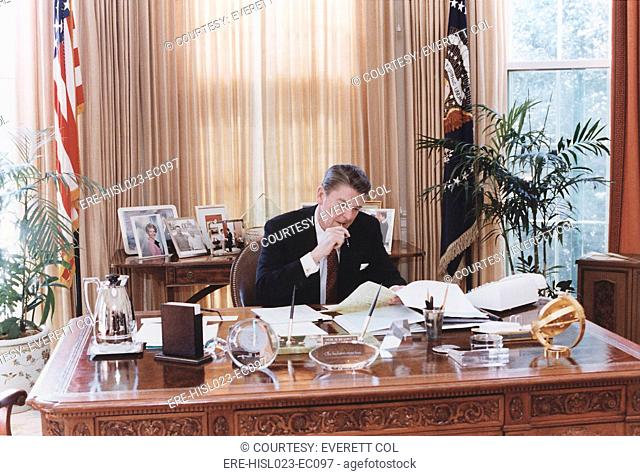 President Reagan working at his Oval Office desk shortly before delivering his 1982 State of the Union address to Congress. Jan 26 1982