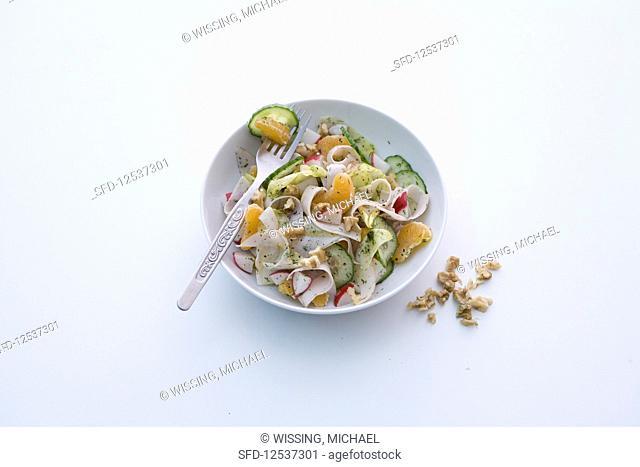 Spicy turkey salad with cucumber, radishes and mandarins