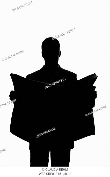 Man holding newspaper, silhouette
