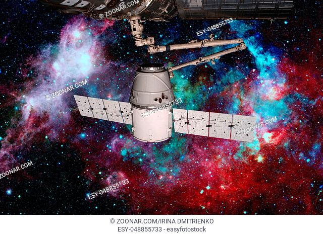 SpaceX Dragon orbiting the planet Earth. Elements of this image furnished by NASA