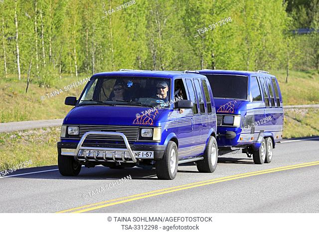 Salo, Finland. May 18, 2019. Blue Starcraft van with similar van converted into a caravan on the road on Salon Maisema Cruising 2019