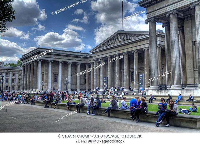 HDR image of people sitting outside the entrance to the British Museum in London