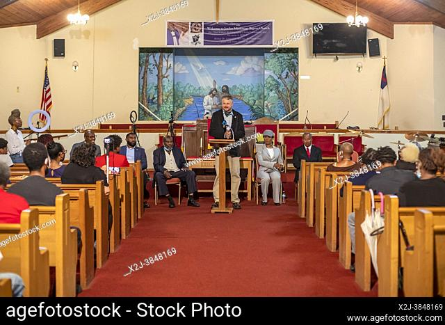 Detroit, Michigan - Candidates for the District 4 seat on Detroit City Council talk with voters during a candidates forum at Jordan Missionary Baptist Church