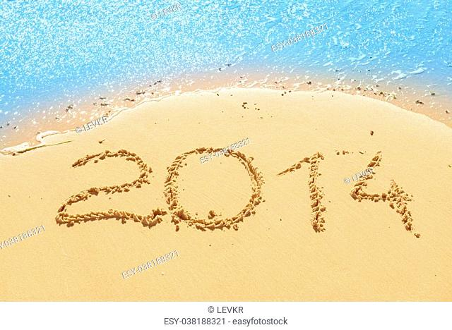 digits 2014 on the sand seashore - concept of new year and passing of time