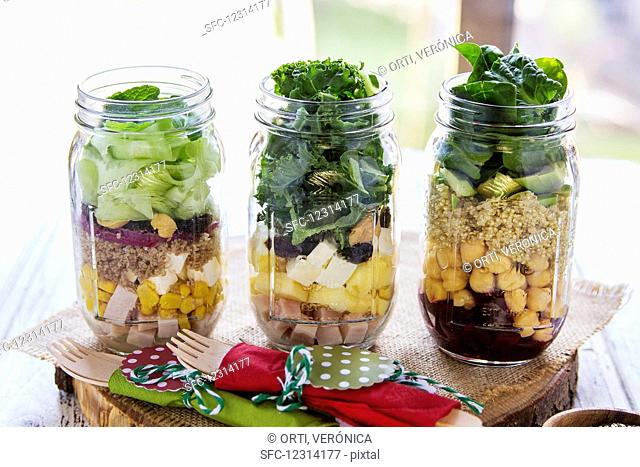 Different salads in jars prepared for a brunch in a buffet