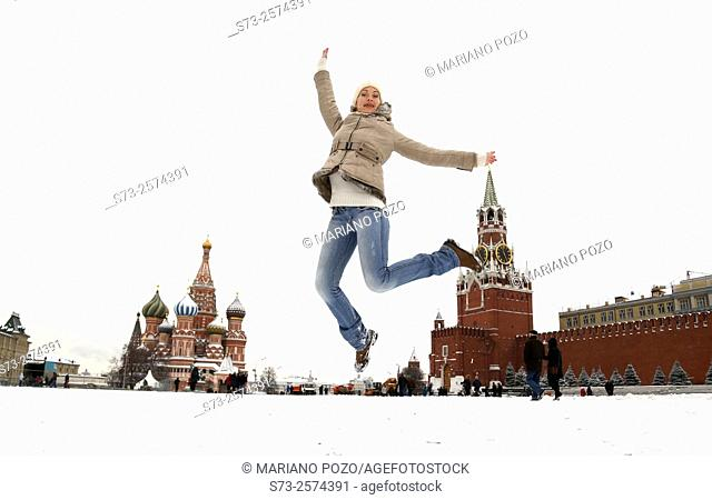 Young woman jumping on the Red Square in Moscow, Russia
