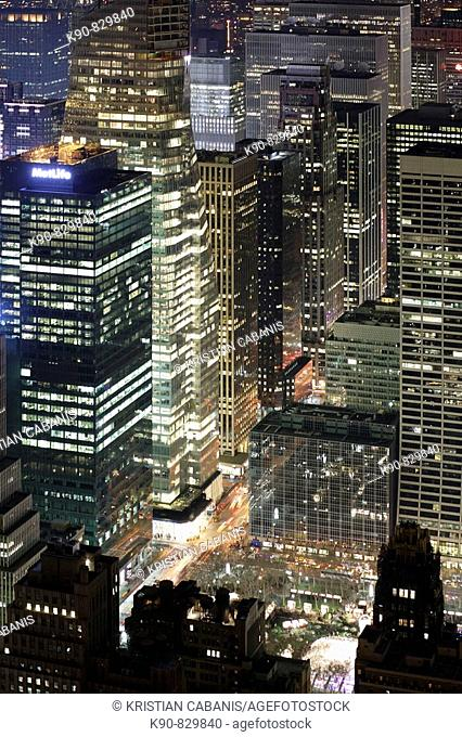 View from the Empire State Building to the buildings of Sixth Avenue and the Bryant Park at night, Manhattan, New York City, North America