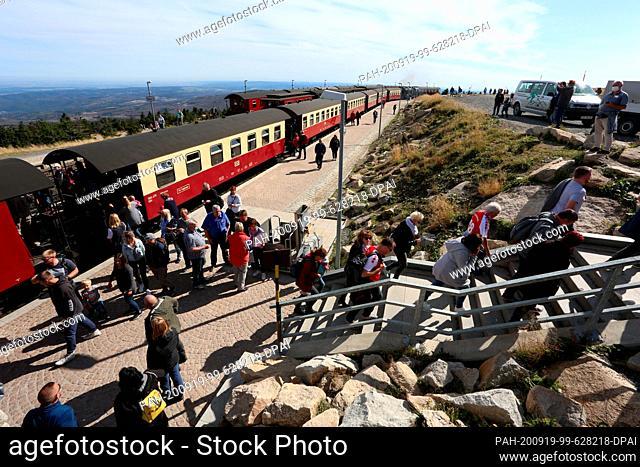 "19 September 2020, Saxony-Anhalt, Schierke: Passengers get off the train of the Harz narrow-gauge railway HSB at the station """"Brocken"""""