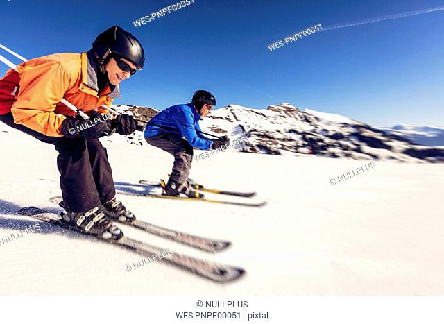 Austria, Damuels, woman skiing in winter landscape