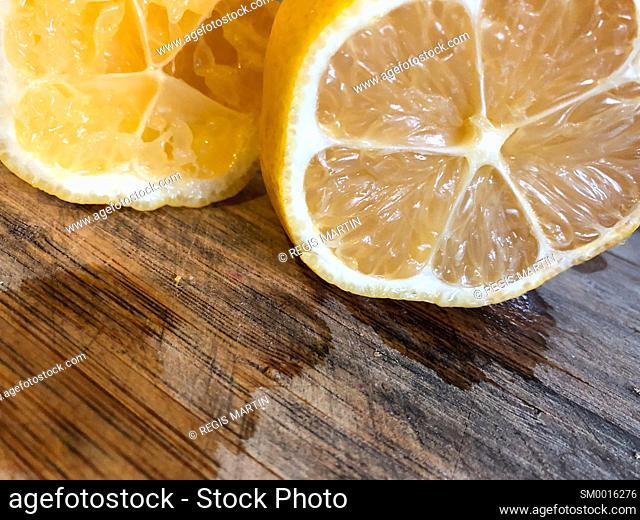 Open lemon on a cutting board