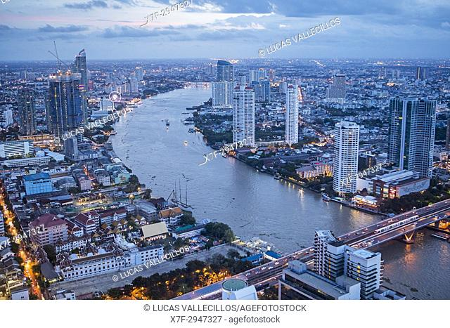 Skyline and Chao phraya River at night, downtown, Bangkok, Thailand