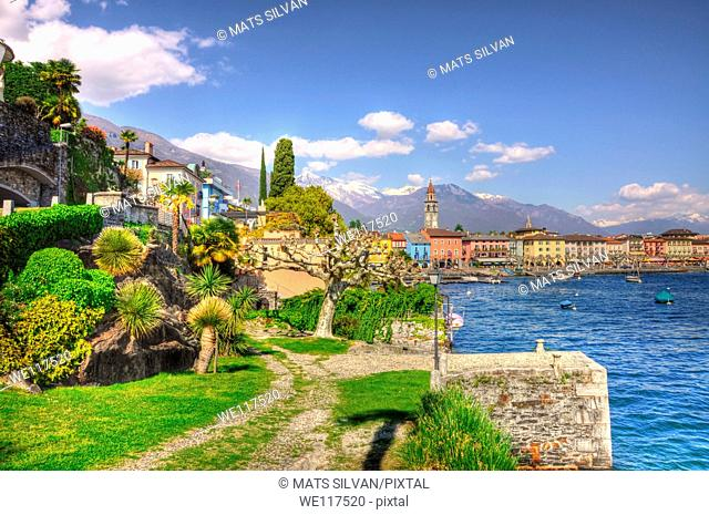 Village on the lake front with snow-capped mountain
