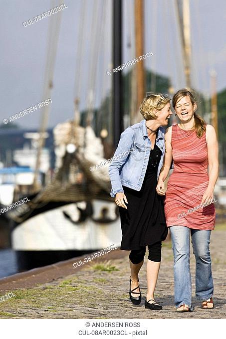 Women walking on a pier