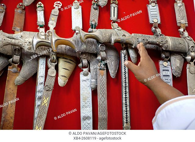 Oman, Nizwa, selling traditional daggers