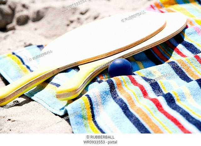 Paddles on a towel at the beach