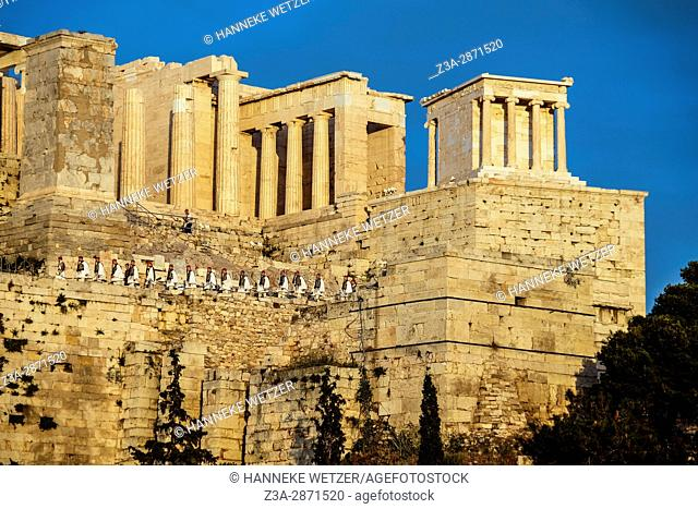 The Greek Presidential Guard walking onto the acropolis to get the flag, seen from the Areopagus hill, Greece