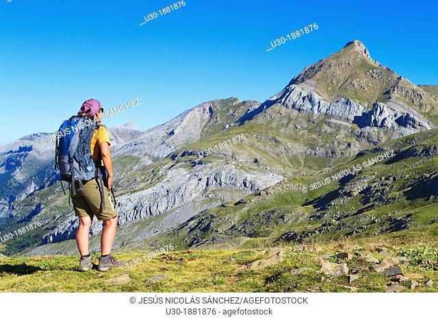 Mountaineer watching Agueri Peak 2 449 m from the ascent to Bisaurín 2 676 m between Hecho valley and Aragües valley  Aragües del Puerto, Aragón  Spain