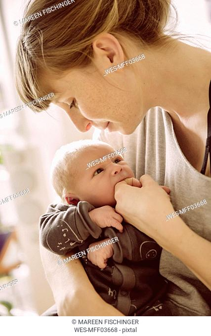 Mother testing newborn babyÔÇÖs hunger with her finger